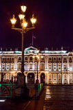 Palace square and Winter palace in Sankt - Petersb. Lanterns Palace Square against a facade of the Winter palace at night Stock Image