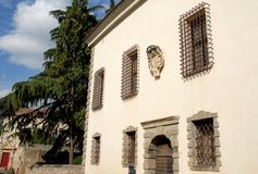 Palace with sturdy bars on the windows in Monselice through the hills in the Veneto (Italy) Stock Photo