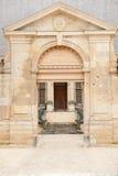 Palace of Tau entrance. Entrance to famous archiepiscopal Palais du Tau im Reims, France Royalty Free Stock Photography