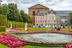 Palace of Trier with fountain. TRIER, GERMANY - AUGUST 22,2014 - Palace of Trier with fountain. Trier lies in a valley between low vine-covered hills of red Stock Photos