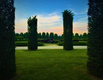 Palace of Venaria Reale, garden and trees. Palace of Venaria Reale and its royal garden, sky and sunset, path, trees, field, romantic view, sentimental landscape royalty free stock images