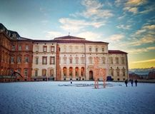The Palace of Venaria in a winter day. One of the courtyards of the Reggia di Venaria Reale Turin, Italy covered with snow stock photos