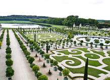 Palace Versailles , beautiful ornamental gardens. Famous palace Versailles - beautiful ornamental gardens and French chateau. National landmark of France Royalty Free Stock Photography