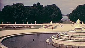 Palace of Versailles fountain. Fountain in the gardens of the Parisian Palace of Versailles with tourists in 1976. Historic archival footage in Paris city of stock video footage