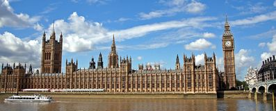 Palace of Westminster. And Big Ben cloth tower viewed over river Thames, London, England Royalty Free Stock Photo