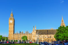 Palace of Westminster and Big Ben with unidentified people. London, UK - June 20, 2016: Palace of Westminster and Big Ben with unidentified people. The Palace is Royalty Free Stock Images