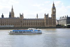 Palace of Westminster with Elizabeth Tower and Westminster Bridge over River Thames in London, England Stock Photo