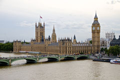 Palace of Westminster - The Houses of Parliament and Big Ben. The Houses of Parliament and Big Ben, River Thames and Westminster Bridge - road and foot traffic Stock Photography