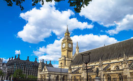Palace of Westminster, Houses of Parliament. UNESCO World Heritage Site. Palace of Westminster fragment (known as Houses of Parliament) with clock tower located Stock Photos