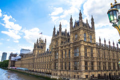Palace of Westminster, Houses of Parliament. UNESCO World Heritage Site. Palace of Westminster fragment (known as Houses of Parliament) located on bank of River Royalty Free Stock Photos