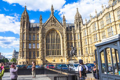 Palace of Westminster, Houses of Parliament. UNESCO World Heritage Site. Unidentified tourists  near Palace of Westminster fragment (known as Houses of Royalty Free Stock Image