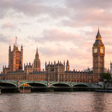 Palace of Westminster, London. A dusk view over the River Thames, London, of the Palace of Westminster, the seat of UK government. Big Ben is visible to the royalty free stock photos