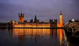 Palace of Westminster in night illumination. Panoramic view of the Palace of Westminster in night illumination from the South Bank of the Thames in London stock photography