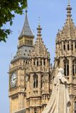 Palace of Westminster, parliament,  statue of George V, Big Ben, London,United Kingdom. England. The Palace lies on the north bank of the River Thames in the Royalty Free Stock Image