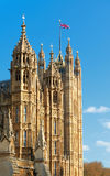 Palace of Westminster, Victoria Tower with British flag on top. Palace of Westminster,  the seat of UK politics and government, in London, UK. Victoria Tower Stock Photo