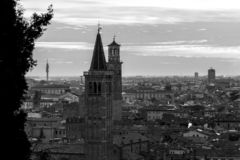 Palaces, Belltowers, Houses and cypress. Veronese bell towers portrayed in black and white from the hills, among the elms on a beautiful winter day with a clear royalty free stock photos