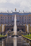 The Palaces, Fountains, and Gardens of Peterhof Grand Palace in Saint-Petersburg, Russia. Grand Peterhof Palace, the Grand Cascade and Samson Fountain. Peterhof Royalty Free Stock Image