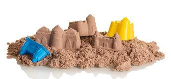 Palaces and towers, made of sand, toys isolated on white. The palaces and towers, made of sand, toys isolated on white background royalty free stock photo