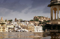 Palaces in Udaipur. Palaces reflected in Lake Pichola, Udaipur, Rajasthan, India. Storm brewing Stock Image