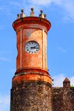 Palacio de Cortes VII. Tower with clock of the Palacio de Cortes located in the city of cuernavaca, morelos, mexico Royalty Free Stock Photography