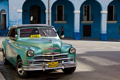 Palacio de Junco and a typical Cuban taxi, Matanzas, Cuba Royalty Free Stock Image