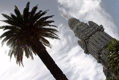 Palacio Salvo. A palm tree and the Palacio Salvo in Montevideo, Uruguay Royalty Free Stock Photo