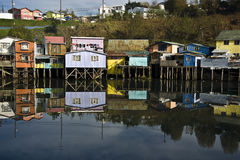 Palafito houses above the water in Castro, Chile Stock Photo