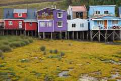 Palafitos of Chiloé. Palafitos. Traditional wooden houses built on stilts along the waters edge in Castro, capital of the Island of Chiloé. These traditional Stock Photo