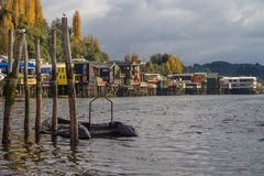 Palafitos in front of the seashore, the traditional houses of wood from the Chiloe Island stock photography