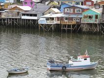 Palafitos houses in Castro, island of Chiloe in Chile. Houses built on stilts, known locally as Palafitos, lining the waters edge in Castro, capital of the Royalty Free Stock Photography