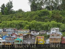 Palafitos houses in Castro, island of Chiloe in Chile. Houses built on stilts, known locally as Palafitos, lining the waters edge in Castro, capital of the Royalty Free Stock Photos