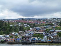 Palafitos houses in Castro, island of Chiloe in Chile. Castro, island of Chiloe, Chile - dec 18, 2013 - Houses built on stilts, known locally as Palafitos Stock Image