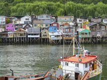 Palafitos houses in Castro, island of Chiloe in Chile. Houses built on stilts, known locally as Palafitos, lining the waters edge in Castro, capital of the Stock Images