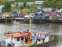 Palafitos houses in Castro, island of Chiloe in Chile. Houses built on stilts, known locally as Palafitos, lining the waters edge in Castro, capital of the Stock Photos