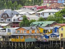 Palafitos houses in Castro, island of Chiloe in Chile. Houses built on stilts, known locally as Palafitos, lining the waters edge in Castro, capital of the Stock Photography