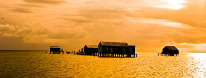Palafitos. Houses over logs in the water, mexican caribbean Royalty Free Stock Images