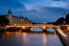 Palais de Justice, night view over the Seine Stock Images