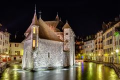 Palais de l'Isle in Annecy, France. Palais de l'Isle is a castle in the center of the Thiou canal in Annecy, France, built in 1132. The Palais de l'Ile was royalty free stock images