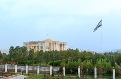 Palais des Nations and flagpole with a flag. Dushanbe, Tajikistan Royalty Free Stock Images