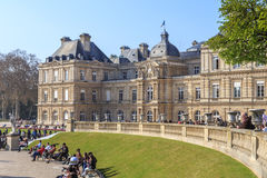 Palais du Luxembourg. The Palais du Luxembourg (Luxembourg Palace) in the Jardin du Luxembourg, in Paris, France, with people sitting outside, relaxing in the royalty free stock photos