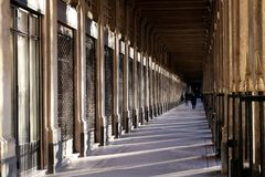 Palais royal gardens arcade at sunset in Paris. The romantic appeal of the Palais-Royal a quiet retreat in the center located in the 1st arrondissement France stock image