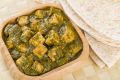 Palak Paneer. South Asian curry made with paneer (cheese) with pureed spinach sauce Royalty Free Stock Photo