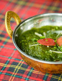 Palak paneer with tomatoes . Indian dishes Stock Image