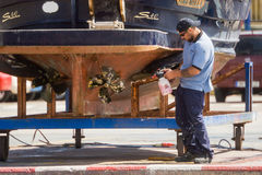 Palamos, Catalonia, may 2016: Fisherman cleaning and repairing m Royalty Free Stock Photography