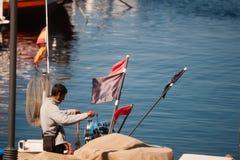 Palamos, Catalonia, may 2016: fisherman inspect and repairing fi Stock Image