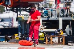 Palamos, Catalonia, may 2016: fisherman inspect and repairing fi Stock Images