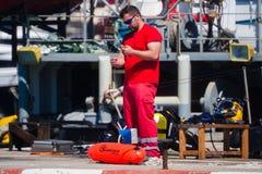 Palamos, Catalonia, may 2016: fisherman inspect and repairing fi Royalty Free Stock Image