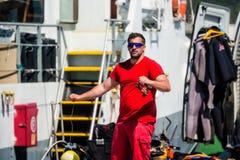 Palamos, Catalonia, may 2016: fisherman inspect and repairing fi Stock Photography