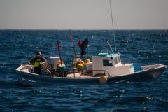 Palamos, Catalonia, may 2016: Fisherman on a small boat Stock Photography