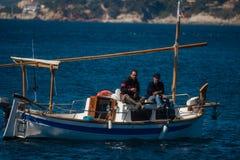 Palamos, Catalonia, may 2016: Fishermen on a small boat Royalty Free Stock Photo